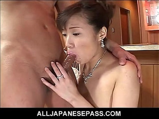 Japanese milf in a red evening gown fucked