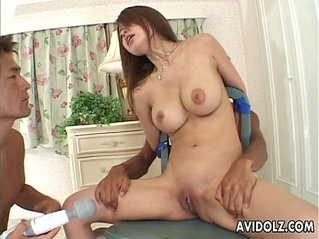 Petite Japanese babe servicing two cocks uncensored.